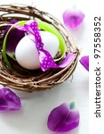 easter egg with ribbon in a nest - stock photo