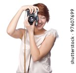 Attractive funny girl with a camera over white background - stock photo