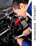 male mechanic fixing an engine... | Shutterstock . vector #97616657