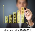 businessman drawing upward trend bar chart - stock photo