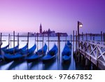 San Giorgio Maggiore church and gondolas at twilight in Venice - Italy. - stock photo