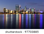 Perth, Western Australia, viewed at night reflected in the Swan River. - stock photo