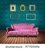 vintage luxury armchair and frame in green wallpaper room - stock photo