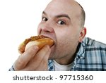 man eats a hot dog - stock photo