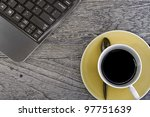 Coffee on wood floor with laptop - stock photo