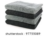 stacked black and grey bathroom towels on a white background - stock photo