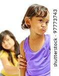 asian ethnic teenage girl persuade moody kid - stock photo