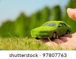 hand holding eco car icon...