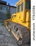 The crawler tractor to demolish homes - stock photo