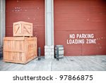 2 wooden boxes in front of cargo storage house - stock photo