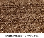 A background image of a plowed field - stock photo