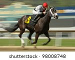 "ARCADIA, CA - MARCH 15: Jockey Joe Talamo pilots ""All Squared Away"" to a 2nd place finish in an allowance race at Santa Anita Park on March 15, 2012 in Arcadia, CA. - stock photo"