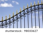 Iron gate with selective focus in the middle. - stock photo