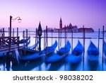 San Giorgio Maggiore church and gondolas at dawn in Venice. - stock photo