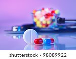 Pills and tablets macro still life on violet, medical therapeutic concept - stock photo
