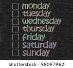 weekly days plan with box written on blackboard background - stock photo