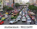 BANGKOK - MARCH 7: Traffic moves slowly along a busy road on March 7, 2012 in Bangkok, Thailand. Annually an estimated 150,000 new cars join the already heavily congested streets of Bangkok. - stock photo