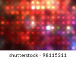 Decorative christmas background - defocused reflection of lights. - stock photo
