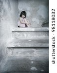 little girl bare feet on the basement stairs - stock photo