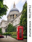 St Paul's Cathedral and a classic red British telephone box in London - stock photo