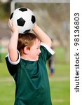 young boy playing soccer in... | Shutterstock . vector #98136803