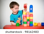 Two years child with colorful construction set - stock photo