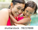 asian ethnic portrait of happy mother and little girl in swimsuit - stock photo