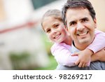 father giving her daughter a... | Shutterstock . vector #98269217