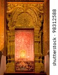 Golden doorway in buddha temple - stock photo