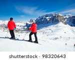 Skiers Overlooking The Piste A...