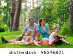 happy family having fun outdoors on a sunny day - stock photo