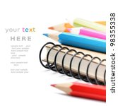 Colorful pencils and notebook isolated over white with copyspace - stock photo