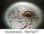 a lot of fake blood drops in metal kitchen sink - stock photo