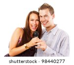 attractive young couple singing | Shutterstock . vector #98440277