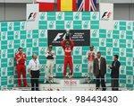 SEPANG, MALAYSIA - MARCH 25: Race winner Fernando Alonso of Ferrari F1 Team holding the trophy on podium  at F1 Petronas Malaysian Grand Prix on March 25, 2012 in Sepang, Malaysia - stock photo