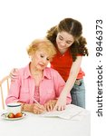 Small photo of Teen girl helping her grandmother fill out paperwork or absentee ballot. Isolated on white.
