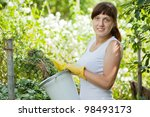 female farmer making compost in ...