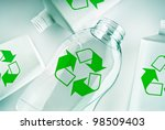 plastic containers with the green recycle symbol - stock photo
