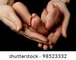 baby`s feet in mother`s hands - stock photo