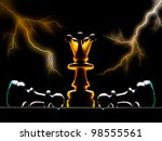 Chessmen on a chess board. A dark background and art illumination. - stock photo