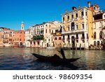 Tourists enjoying the ride of a gondola in Grand Canal , Venice - Italy - stock photo