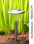 Solar garden light in the home garden. - stock photo