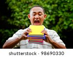 ethnic asian male student hungry of knowledge education - stock photo
