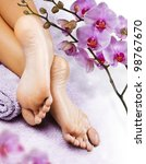 Foot massage in the spa salon - stock photo