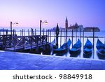 San Giorgio Maggiore church and gondolas at dawn in Venice - Italy - stock photo