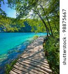 Blue lake and path - stock photo