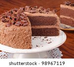 Sliced chocolate layer cake on a platter - stock photo