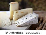 Three kinds of french cheese and Grissini breadsticks - stock photo