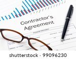Pen, Glasses and Contractor's Agreement Form on desktop in business office. - stock photo