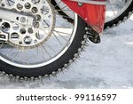 Wheel with spikes of an ice speedway motorbike - stock photo